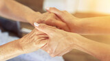 Fototapeta Na sufit - Seniors holding hands for comfort and concern