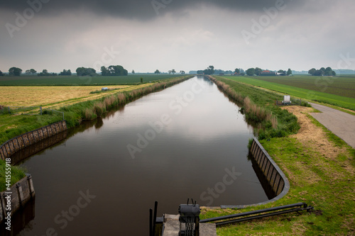 Fototapeta The beautiful canal in the polder named carel coenraadpolder in the province o