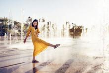 Happy Woman Having Fun Near Fountain