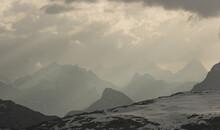 Overcast Sky Over Snowy Mountains