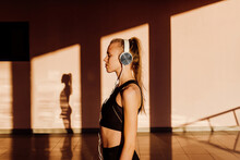 Young Athletic Caucasian Listening To Music At Sunset