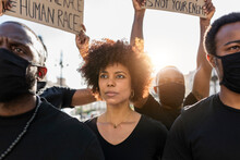 Crop Black Protesters With Placards On Strike In Town