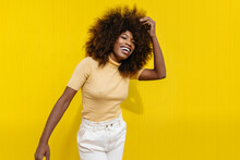 Glad Trendy Black Woman Laughing On Yellow Background