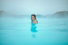 Woman In Water Between Stones