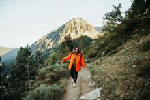 Young Woman Walking On Way Near Mountain