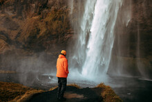Person On Shore Looking At Waterfall