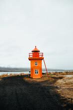 Little Beacon On Shore Near Water