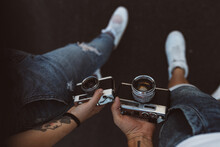 Hands Of People With Retro Cameras