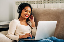 Dreamy Woman With Laptop And Headphones