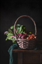 Still Life Of A Basket With Vegetables