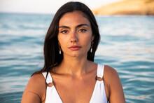 Model In Swimsuit On Beach Against Sea
