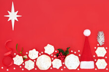 Festive Christmas Background Border Composition On Red With Holiday Symbols And Mince Pies. Abstract Composition For The Xmas Holiday Season. Flat Lay, Top View Copy Space.