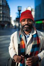 Portrait Handsome Businessman In Stocking Cap On Urban Street