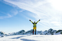 Happy Climber Enjoying Freedom In Snowy Mountains