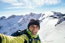 Happy Traveler Taking Selfie In Snowy Mountains
