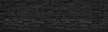 Old Black Shabby Brick Wall Wide Panoramic Texture. Dark Grey Rough Masonry. Aged Brickwork Panorama. Abstract Grunge Background