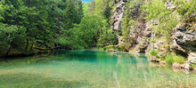 Wild Pond Among Rocks