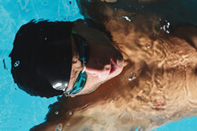 Sportsman In Goggles Swimming In Pool During Workout