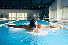 Sportsman In Goggles Swimming In Pool During Training