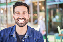 Smiling Ethnic Man With Beard In Restaurant