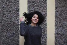Happy Ethnic Woman With Curly Hair In City