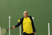 Senior Man Playing Tennis In Gym