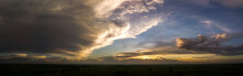 Panorama Top View Aerial Photo From Flying Drone Over Rice Fields And Small Village In Thailand.Top View Beautiful Sunset.Sunrise With Cloud Rainy Storm.