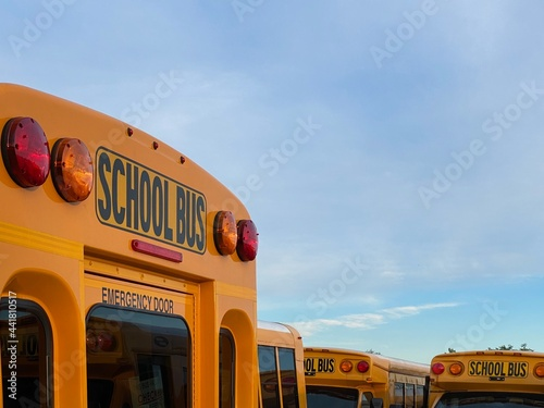 Obraz na plátně Yellow School Bus With Red Brake Lights In Mount Vernon New York