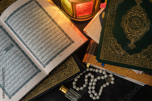 Obraz na plátně High Angle View Of Quran Holy Book, Beads And Lantern