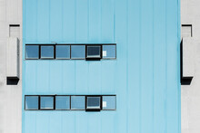 White Building Against Blue Sky Seen Through Window