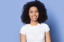 Headshot Portrait Of Smiling African American Woman Isolated On Blue Background Feel Optimistic. Profile Picture Of Happy Biracial Female Look At Camera Show White Healthy Teeth. Diversity Concept.