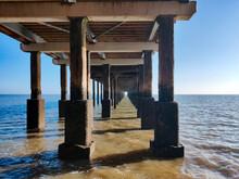 Wooden Pier On Sea Against Sky