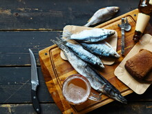 Glasses Of Beer, Slices Of Black Bread And Dried Fish On A Kitchen Cutting Board. Food Background.