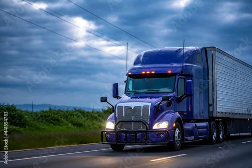 Fotografie, Obraz Stylish blue big rig semi truck transporting frozen cargo in refrigerator semi t