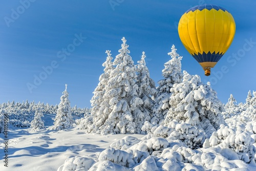 balloon flies into the sky, winter landscape from a height of