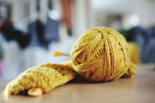 Close-up Of Yellow Yarn On Table