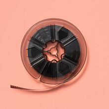Reel Of Super-8 Movie Film On A Pink Background