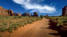 Arizona, Monument Valley Tribal Park, Empty Dirt Road In Desert In Monument Valley