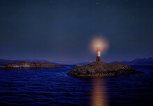 Argentina, Patagonia, Ushuaia, Beagle Channel, Illuminated Lighthouse On Rocky Islet At Night