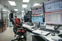 In The System Monitoring Room Or Control Room Work On Many Monitor. Facility Is Full Of Screens Showing Plant Process