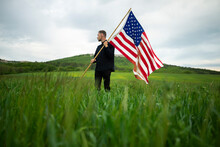 Young Man With American Flag In Wheat Field