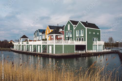 Houses By Lake Against Sky Fotobehang