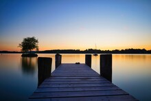 Pier Over Lake Against Sky During Sunset - Frauenchiemsee
