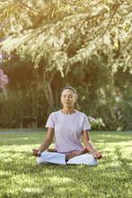 Woman Sitting On Lotus Pose In Park