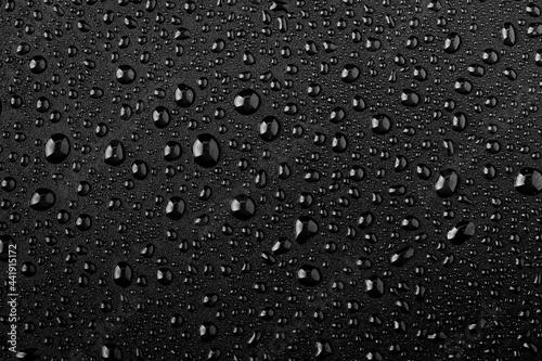 Water droplets on black background Fotobehang