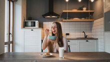 Woman Eating Delicious Cereal For Breakfast At Home