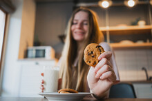 Smiling Woman With Delicious Oat Cookie At Home
