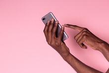 Hands Of Black Man Using Phone