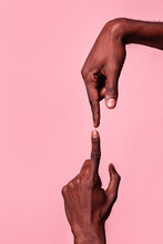 Opposed Hands Of Black Man Pointing At Each Other
