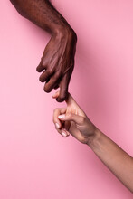 Crop View Of White Woman And Black Man Holding Fingers